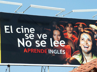 This billboard image is seen from one of the main roads in Oaxaca, Mexico.